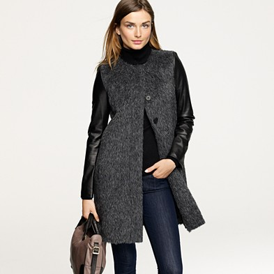 From JCrew:   Black leather sleeves add the perfect exclamation point to this statement-making coat in luxe wool and heathered alpaca (our designers